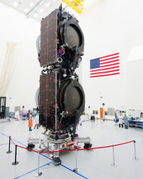 Two Boeing-built, all-electric telecommunications satellites stacked in the position in which they will ride to orbit aboard a SpaceX Falcon 9. Credit: Boeing