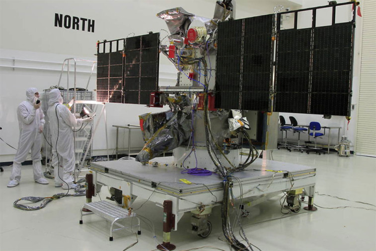 Workers conduct a light test on the solar arrays on NOAA's Deep Space Climate Observatory spacecraft, in the Building 1 high bay at the Astrotech payload processing facility in Titusville, Florida. Credit: NESDIS