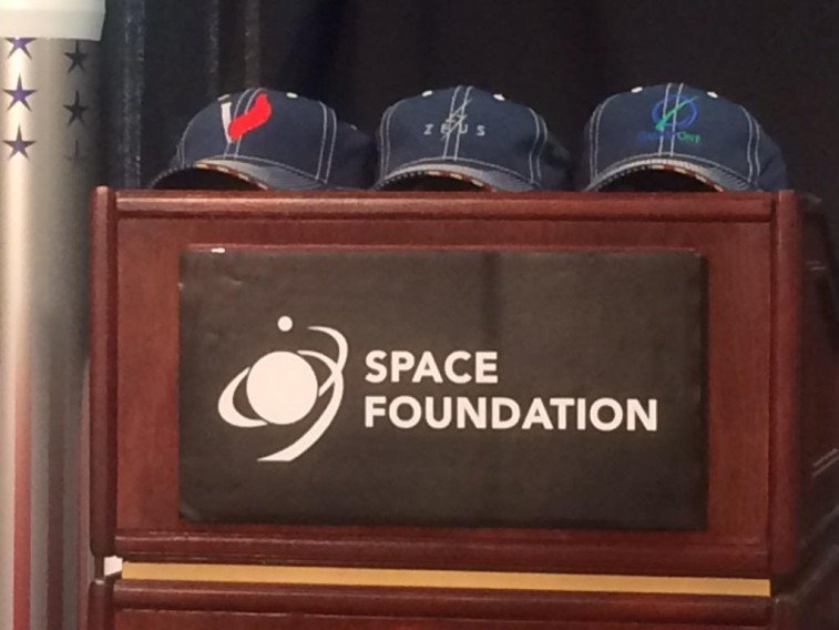 ULA had baseball caps on hand emblazoned with the names of the three finalists. Credit: SpaceNews/Mike Gruss
