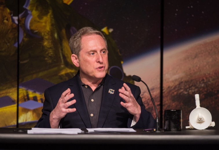Alan Stern, New Horizons principal investigator, Southwest Research Institute, Boulder, Colorado, speaks during a New Horizons mission briefing, Tuesday, April 14, 2015 at NASA Headquarters in Washington, D.C. Panelists in the briefing discussed the goals, scientific objectives and encounter plans as the New Horizons spacecraft approaches its closest encounter with Pluto on July 14th after traveling more than 3 billion miles since its launch on January 19, 2006. The panelists also discussed the types of images and other data that will be collected during the flyby and when it can be expected. Photo Credit: (NASA/Aubrey Gemignani)