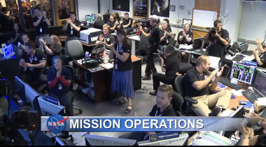 The New Horizons team at the Mission Operations Center celebrates after receiving word the spacecraft had contacted Earth and was in good health. Credit: NASA TV