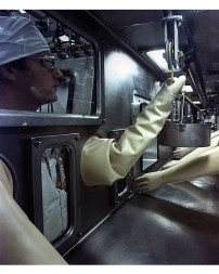 Technicians at DOE's Oak Ridge National Laboratory work in a  glove box where nuclear material, including plutonium-238, is handled. Credit: U.S. Department of Energy