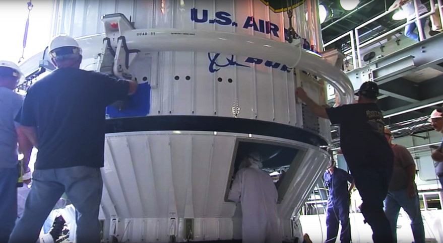 ULA technicians prepare the U.S. Air Force's encapsulated GPS 2-F10 satellite for its July 15, 2015 launch atop an Atlas 5 rocket. Credit: ULA video