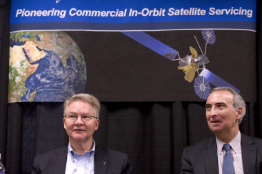 Orbital ATK CEO David W. Thompson and Intelsat CEO Stephen Spengler announce their MEV agreement at the 2016 Space Symposium. Credit: Chuck Bigger