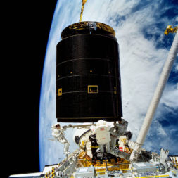 STS-49 astronauts equip Intelsat-6 with a new perigee kick motor in 1992. The satellite was stranded in an unusable orbit since its launch aboard a Titan vehicle two years earlier. Credit: NASA