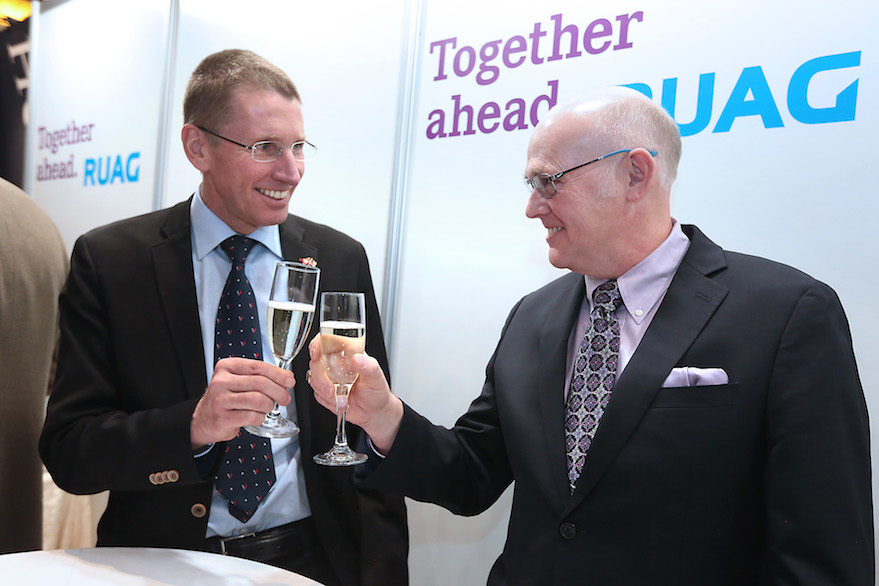 Ruag Space CEO Peter Guggenbach, left, and ULA CEO Tory Bruno toast their business relationship Wednesday at the 33rd Space Symposium. Credit: Tom Kimmell
