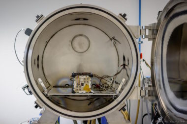 NanoAvionics staff tests the EPSS in a thermal vacuum. Credit: NanoAvionics