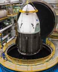 A SpaceX Crew Dragon spacecraft is prepared for thermal vacuum tests at NASA's Plum Brook Station. Credit: SpaceX