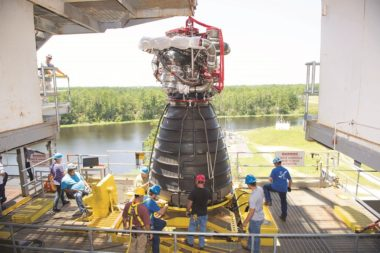 Workers prepare to install an RS-25 engine on the A-1 Test Stand at Stennis Space Center, Mississippi, in preparation for hotfire tests supporting the SLS program. Credit: NASA