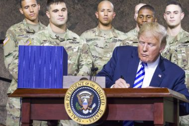 U.S. President Donald J. Trump signs the National Defense Authorization Act of 2019 at Fort Drum, New York, on Aug. 13. The act formally changes the name of the EELV program to the National Security Space Launch program effective March 1. Credit: U.S. Army photo by Sgt. Thomas Scaggs