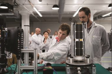 Chester Gillmore, Planet vice president of manufacturing, tours Planet's Dove cubesat factory. Credit: Planet