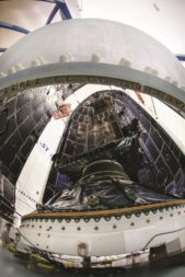 The first of 10 Lockheed Martin-built GPS 3 satellites encapsulated for its Dec. 23 launch aboard a Falcon 9. The Air Force gave Lockheed a $7.2 billion contract last year for up to 22 GPS 3F satellites. Credit: Lockheed Martin