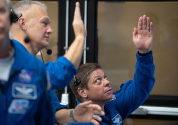 NASA astronauts Doug Hurley, left, and Bob Behnken, right, who are assigned to fly on the crewed Demo-2 mission, watch the March 2 launch of a SpaceX Falcon 9 rocket carrying the company's Crew Dragon spacecraft on the Demo-1 mission from the Launch Control Center at the Kennedy Space Center. Credit: NASA/Joel Kowsky