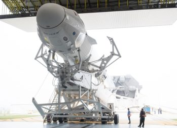 A SpaceX Falcon 9 rocket with the company's Crew Dragon spacecraft onboard is seen as it is rolled out of the horizontal integration facility at Kennedy Space Center's Launch Complex 39A in preparation for the Demo-1 mission that launched March 2. Credit: NASA/Joel Kowsky