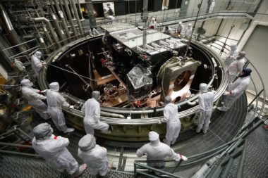 Engineers at Lockheed Martin Space Systems watch the GOES-S Satellite being lowered into the thermal vacuum chamber in 2017. The satellite was renamed GOES-17 following its March 1, 2018 launch aboard a United Launch Alliance Atlas 5 rocket. Credit: Lockheed Martin