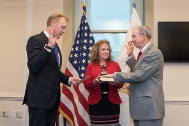 Acting Defense Secretary Patrick Shanahan, left, swears in Mike Griffin as undersecretary of defense for research and engineering Feb. 20, 2018, as Griffin's wife, Rebecca, watches. Credit: DOD photo by Army Sgt. Amber I. Smith